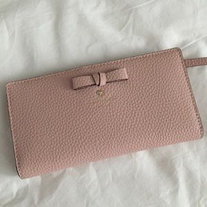 Kate Spade light pink wallet with bow